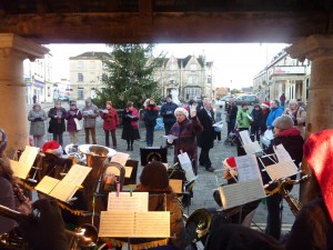 Carolling under the Buttercross with singers by the Chippenham Christmas Tree, 2011